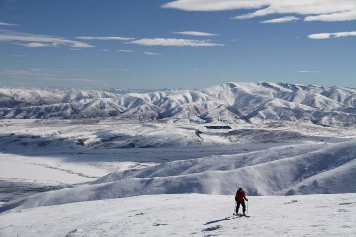 Ascending Hawkdun Range with St Bathans Range in background and view of Mt Aspiring