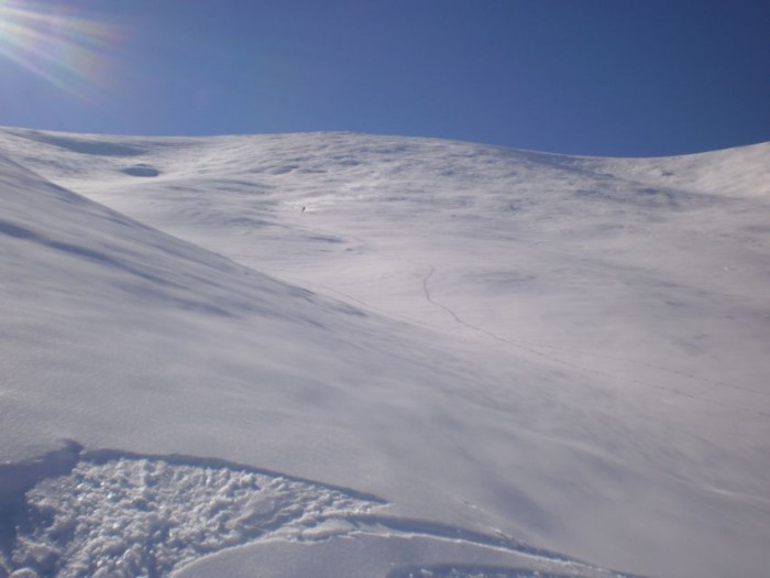 Skiing huge face in Hawkduns. Note skier in centre two thirds the way down the face