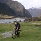 Cycling with AT ski gear on way to Aspiring Hut